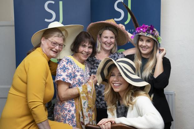 Swayne Johnson solicitors hats off to Headway charity day to raise money for Headway; Pictured are Rosamry Holland from Headway with headway client Cindie Vowles and Swayne Johnson staff Helen Thompson, Natalie Noton and Kristin Charlton.   Picture Mandy
