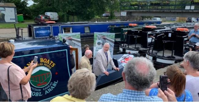 Terry Waite CBE unveils Llangollen's new boat. Picture: Buy Local Llangollen.
