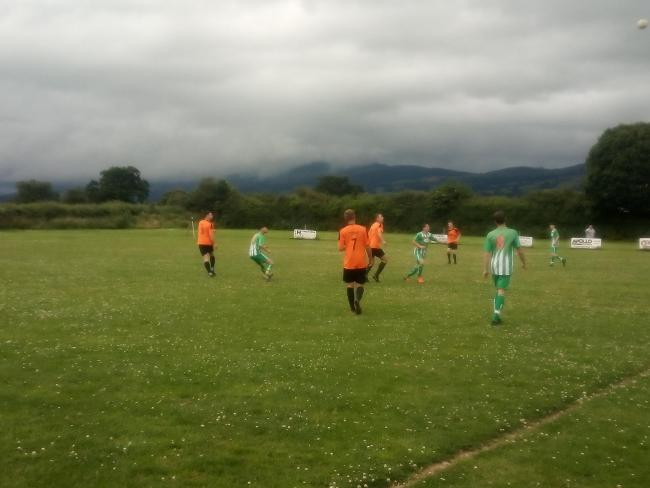 Action from Llangynhafal's 3-2 win over Henllan