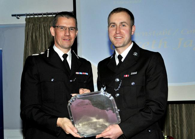 PC Jaggard (right) receiving the Fletcher Bravery Award from former CC Carl Foulkes last year. Picture: North Wales Police