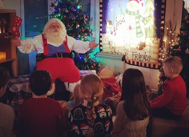 Santa at Rhug last December reading a story to children