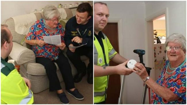 Volunteers provide a vulnerable resident with a smoke alarm. Picture: North Wales Police