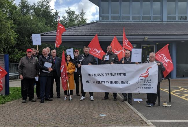 Members of Unite Wales gathered outside a meeting of Betsi Cadwaladr University Health Board at Conwy Business Centre to protest changes to nursing rotas. Source: Liam Randall - Local Democracy Reporting Service