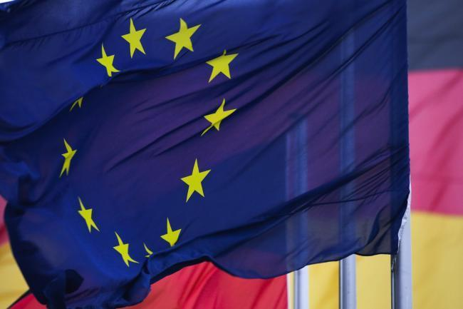 A European flag waves in front of German flags at the Reichstag building in Berlin. Picture: PA/WIRE