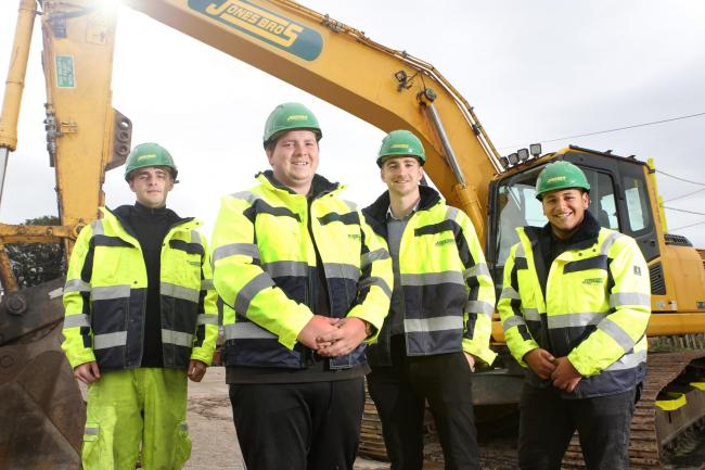 Apprentices Ryan Miller, Jacob Lloyd, and Mustafa Hamed at the Jones Bros training centre in Ruthin with training co-ordinator Garmon Hafal (second from right)