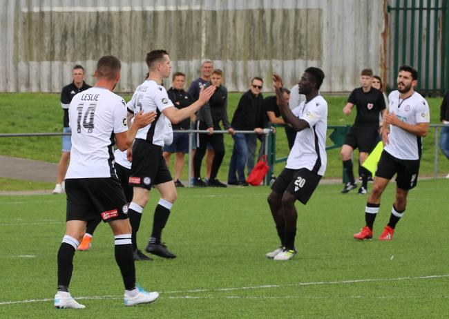 Chris Venables and Lassana Mendes celebrate one of Bala Town's six goals against Penybont.