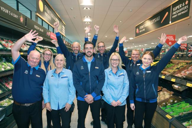 After a successful launch, staff at Aldi on the Marina Quay encourage Rhyl charities to sign up for the scheme