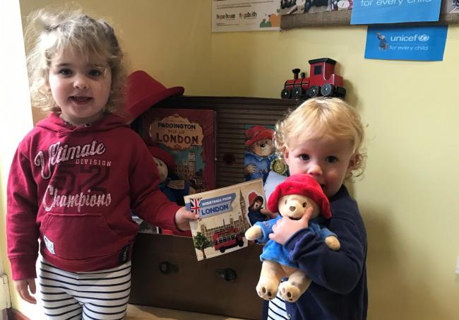 Two children from Corwen Day Nursery with their first postcard from Paddington