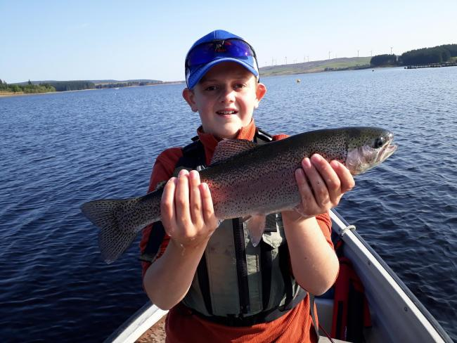 Matthew Davies catches a lovely trout on Llyn Brenig