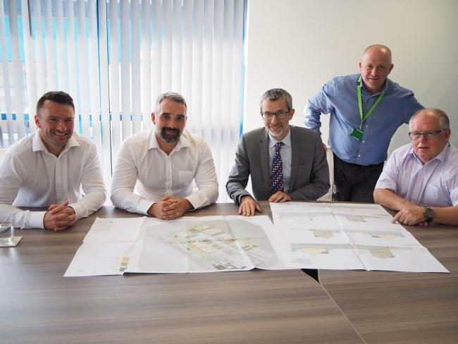 From left: Mark Parry and Howard Vaughan, Brenig Construction Managing Directors; Ffrancon Williams, Adra Chief Executive; Ian Gillespie, Senior Development Surveyor at Adra; and Bleddyn Jones, Brenig Construction Director.