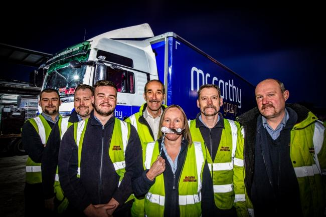 McCarthy distribution take part in Movember........In pic  : Left to right....Lewis Williams, Ian Carter, Harry Jones, Mike McCarthy, Delyth Jones, George Kewley and Spencer Cameron Waller.