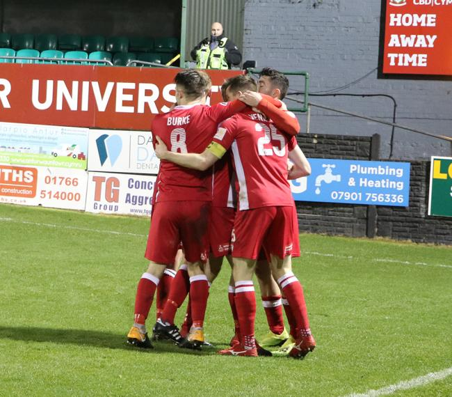 Bala players celebrate one of the goals during the Boxing Day win over Caernarfon Town