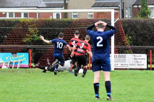 FROM despair to joy!That is the topic of our picture of the week in this edition.This picture was taken by Steve Whitfield and it shows Mark Roberts in the process of scoring Denbigh Town's winner versus Gaerwen on Saturday.With a teammate in the fore
