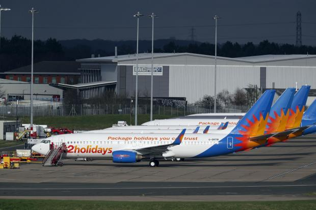 Denbighshire Free Press: AIRLINE: Several Jet2 planes have been parked up at Birmingham Airport during the pandemic. Picture: Steve Parsons/PA