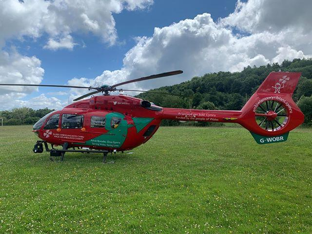 An air ambulance has landed on the field behind Gwernymynydd village hall. (Credit - Pat Forde)