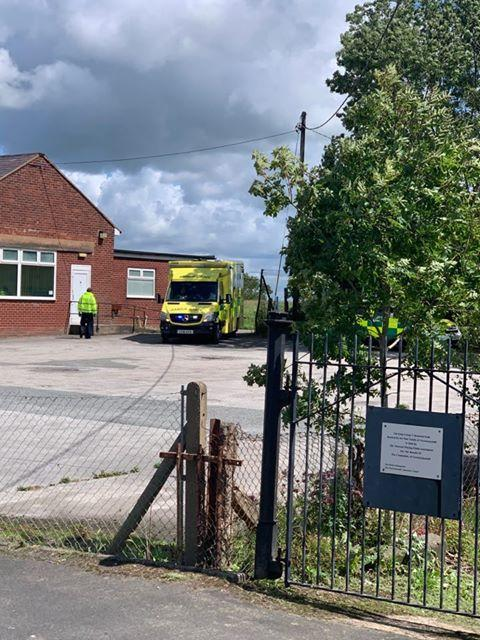 Denbighshire Free Press: An ambulance at the scene at Gwernymynydd village hall. (Credit - Pat Forde)
