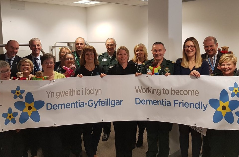 Representatives from the Welsh Ambulance Service and partner agencies celebrating the launch of the Trust's Dementia Plan.