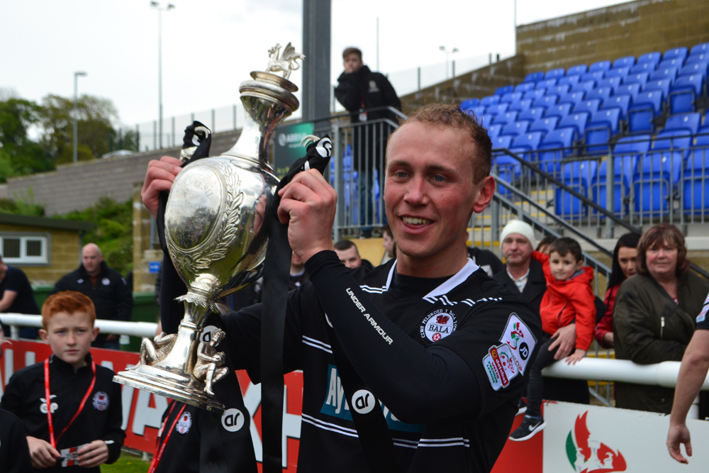 Kieran Smith lifting the Welsh Cup last season