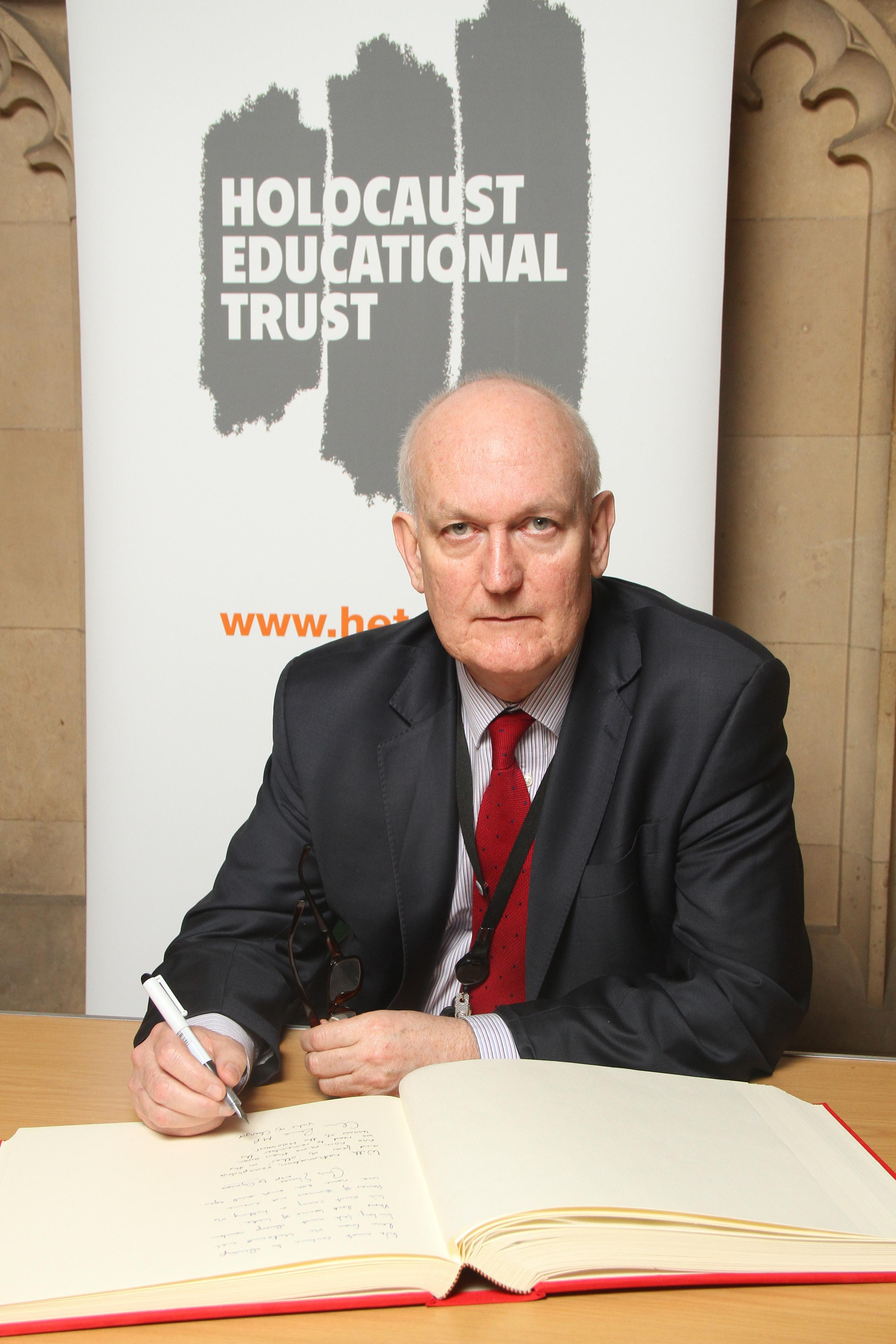 Chris Ruane, MP for Vale of Clwyd, signs book of commitment