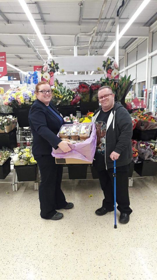 Meinir Ellis from Tesco Ruthin (left), delivering the surplus food to Ian Williams of the volunteer initiative