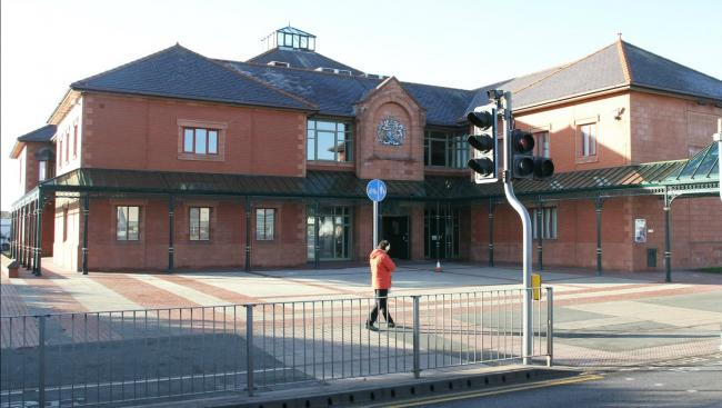 Rhyl man in court after punching wheelchair user