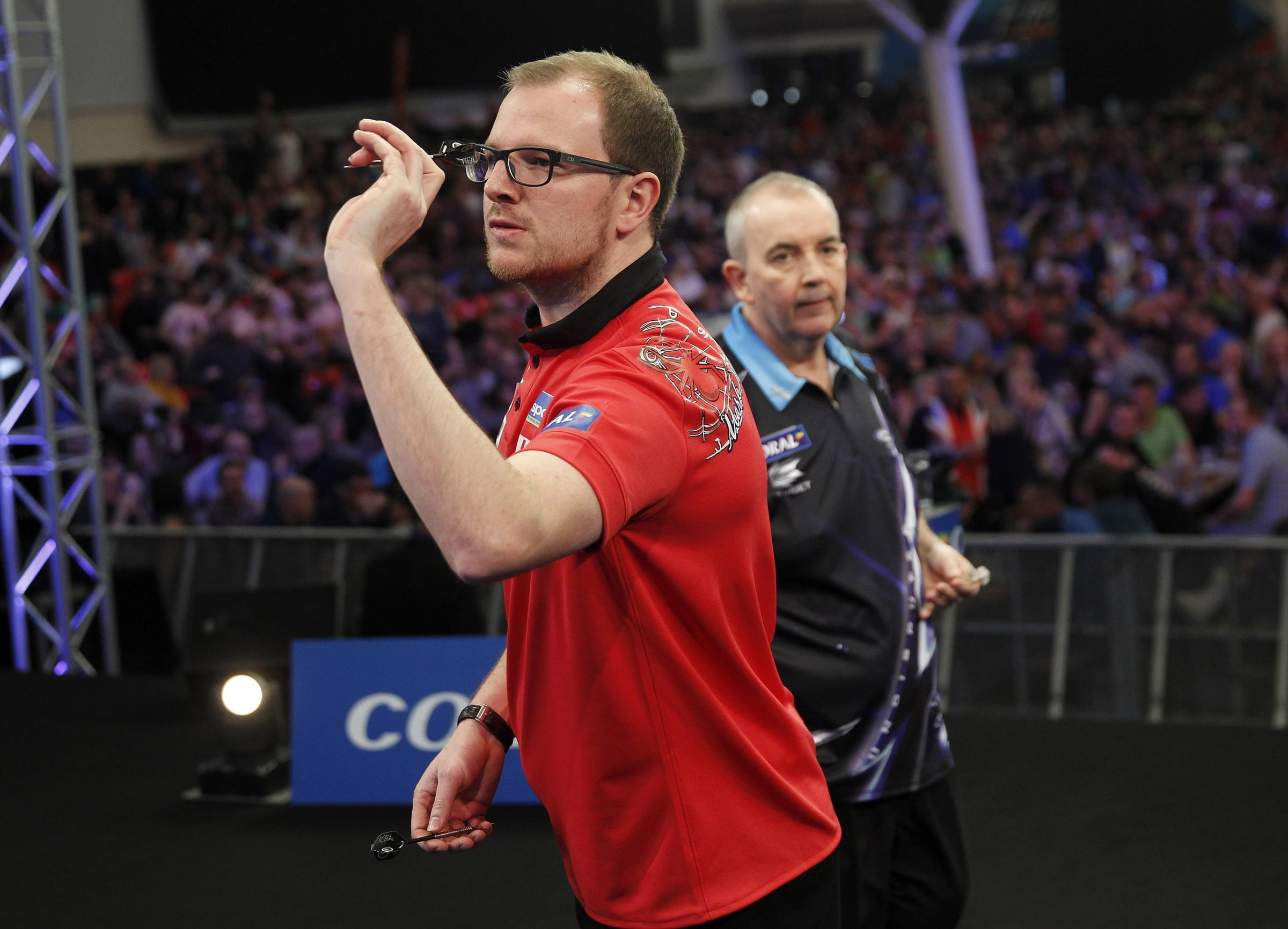 Mark Webster taking on Phil Taylor in the quarter-finals of 2016 UK Open. Picture: Lawrence Lustig / PDC