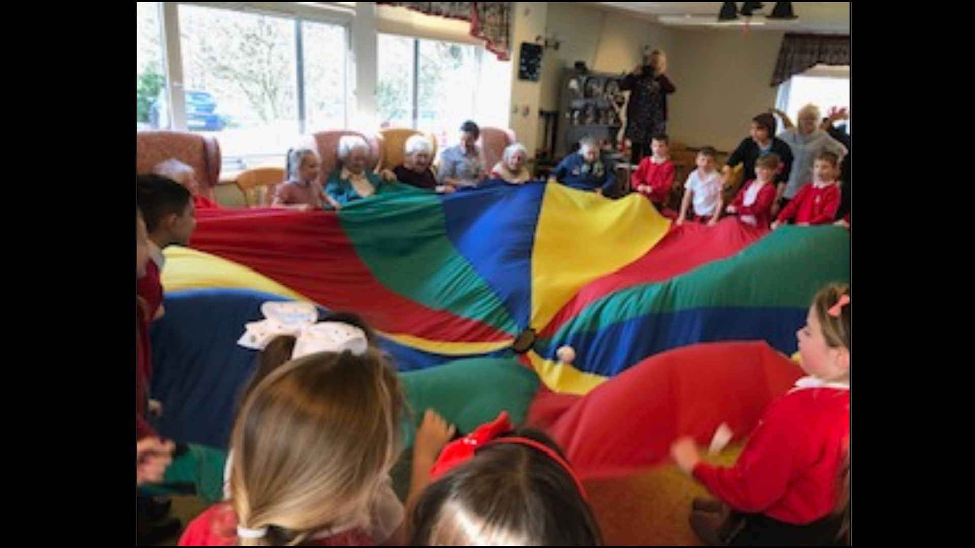 Children from Ysgol Y Parc have formed a firm friendship with the Dolwen Day Care centre in Denbigh