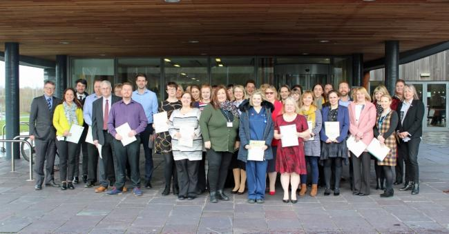 50 of Gr?p Llandrillo Menai receiving their apprenticeship framework certificates in St Asaph