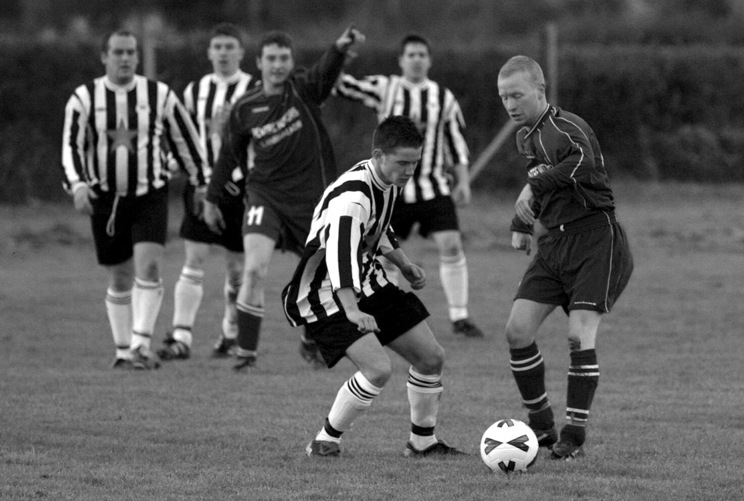 BYGONES: It's derby day in 2004 as Rhewl tackle Llanrhaeadr