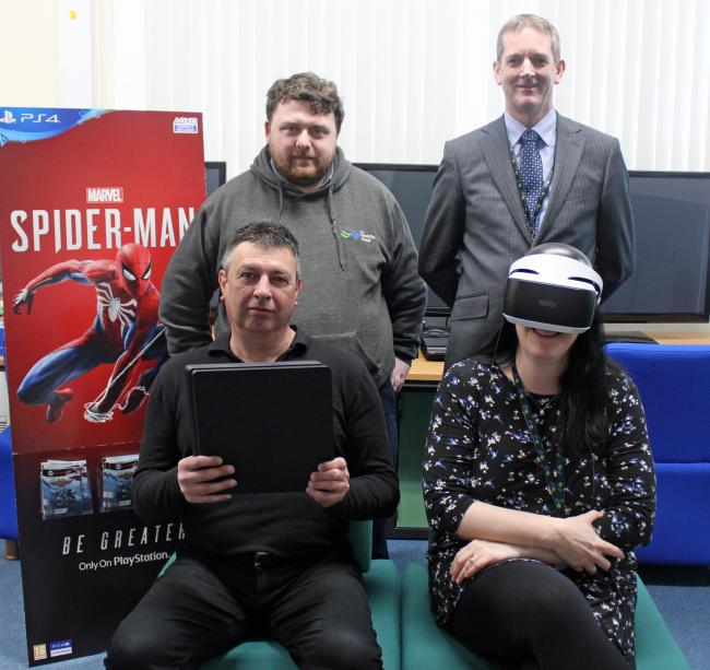 Back row: Rob Griffiths, Computing tutor; and Dave Owen, Programme Area Manager - Computing & Media. Front row: Paul Cornes; student from Prestatyn and Claire Payne, Computing tutor.