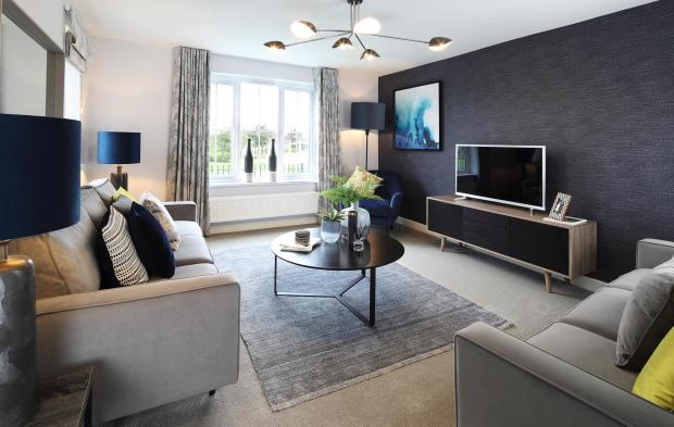 Denbighshire Free Press: A typical Taylor Wimpey living room, which will be available on Glasdir Estate. Picture: Martin J. Toole/Inspired Images
