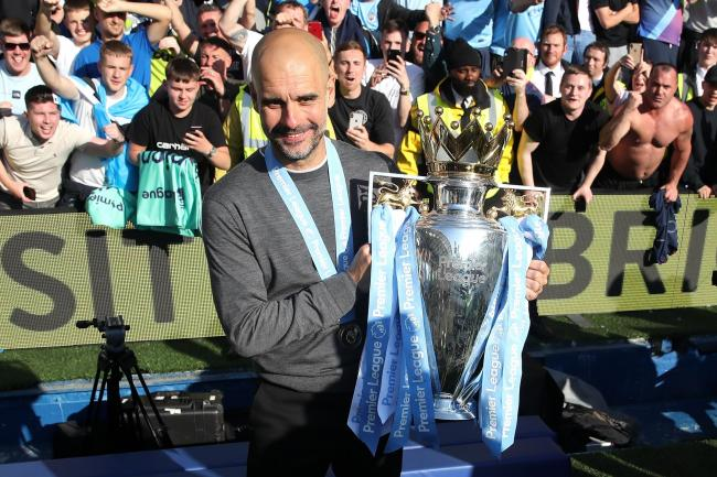 Pep Guardiola with the Premier League trophy