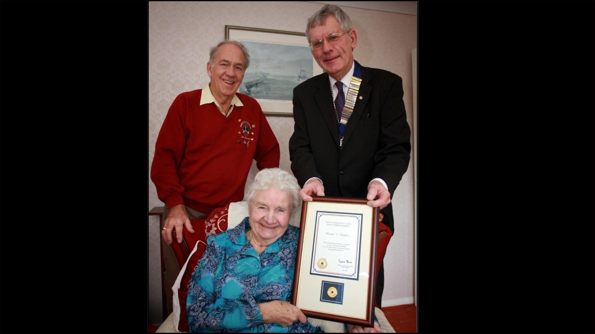 Gerry Beasley and Steve Savory of the Prestatyn and Rhyl Lions Club present Maude Hughes Lions with an award