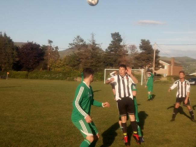 Jason Williams wins a header for Rhewl
